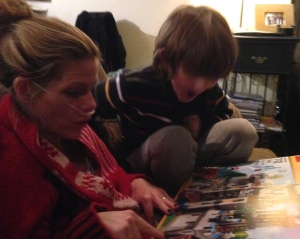Cannula nosed Mommy looking at new lego castle with her very excited (and slightly nervous) little man.